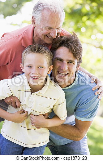Grandfather with adult son and grandchild in park - csp1873123