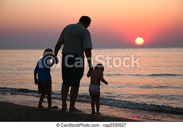Grandfather with children on sunset at sea - csp2330527