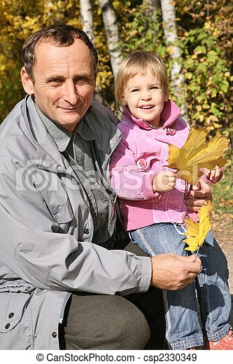 grandfather with the granddaughter in the park in autumn 2 - csp2330349