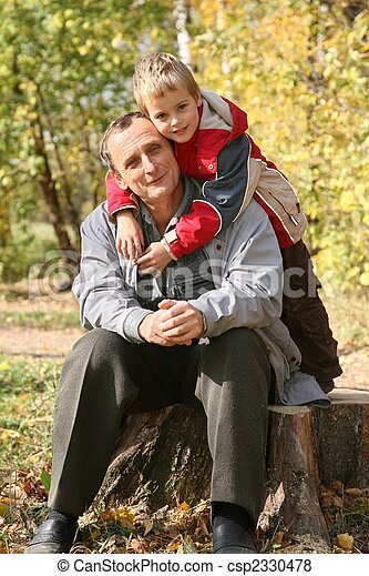 grandfather with the grandson sit in park  in autumn - csp2330478