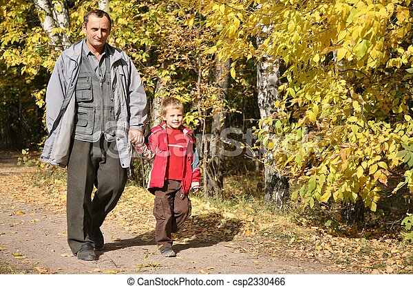 grandfather with the grandson walk in park  in autumn - csp2330466