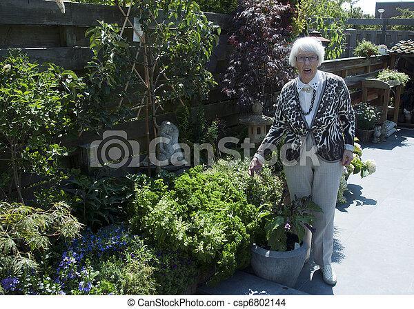Grandma In The Garden   Csp6802144