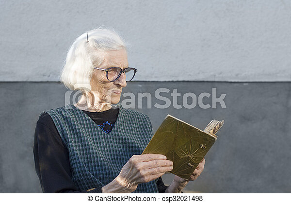 Grandma looking at family photo album - csp32021498