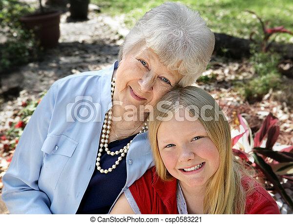 Grandmother & Child in Garden - csp0583221