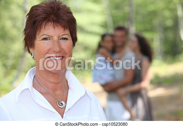 Grandmother enjoying a day out with her family - csp10523080
