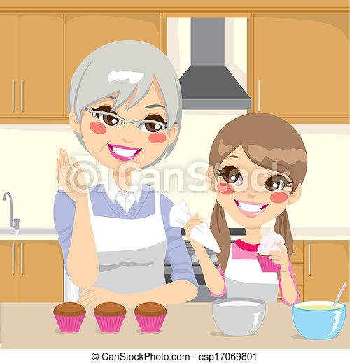 Grandmother Teaching Granddaughter in Kitchen - csp17069801
