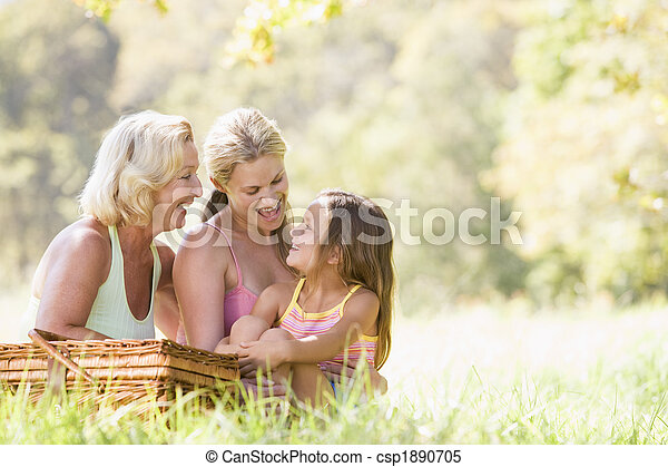 Grandmother with adult daughter and grandchild on picnic - csp1890705