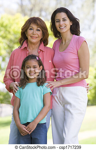 Grandmother with adult daughter and grandchild in park - csp1717239