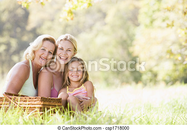 Grandmother with adult daughter and grandchild on picnic - csp1718000