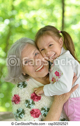 Grandmother with granddaughter  in park - csp30202521