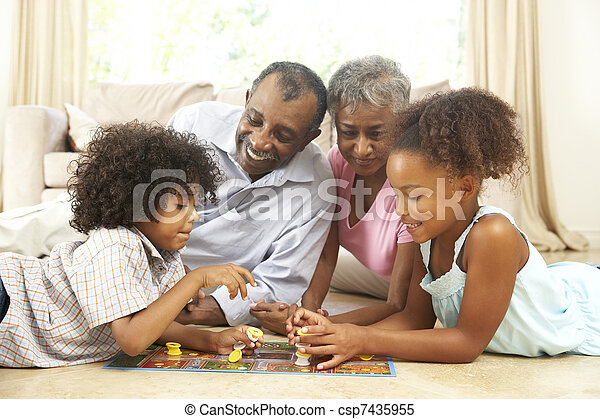 Grandparents Playing Board Game At Home With Grandchildren - csp7435955