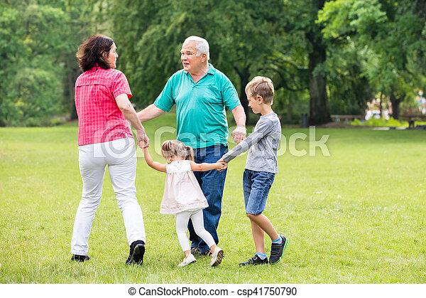 Grandparents Playing With Their Grandchildren - csp41750790