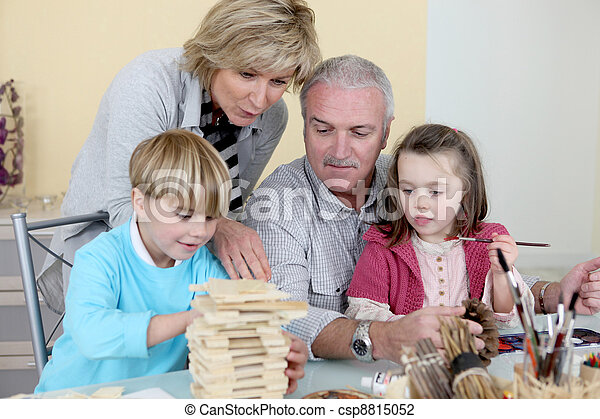 Grandparents spending time with their grandchildren - csp8815052