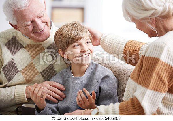 Grandparents taking care of grandson - csp45465283