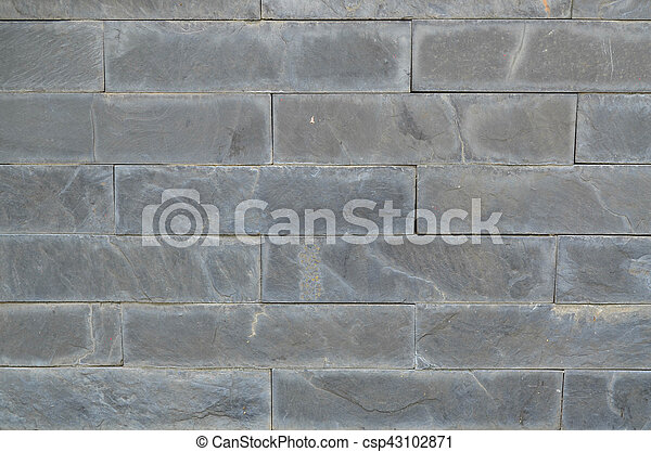 Granite stone wall texture and background - csp43102871