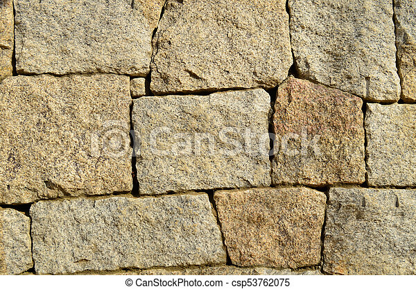 Granite stone wall texture and background - csp53762075