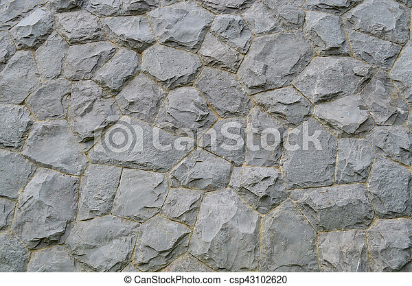 Granite stone wall texture and background - csp43102620