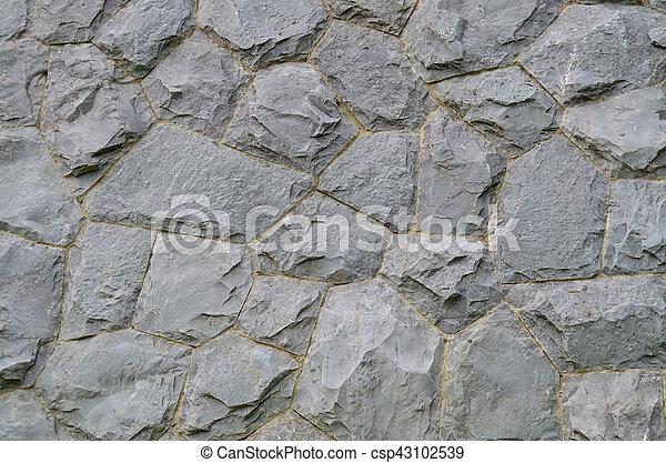 Granite stone wall texture and background - csp43102539