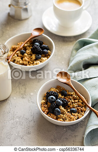 Granola with fresh berries for breakfast - csp56336744