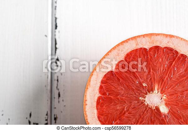 Grapefruit on white wooden background - csp56599278