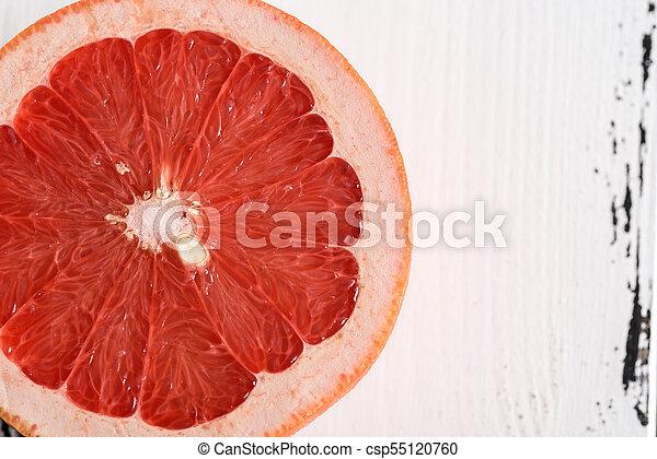 Grapefruit on white wooden background - csp55120760