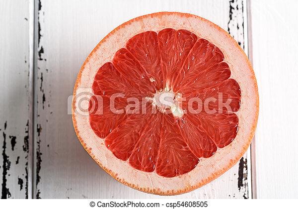 Grapefruit on white wooden background - csp54608505