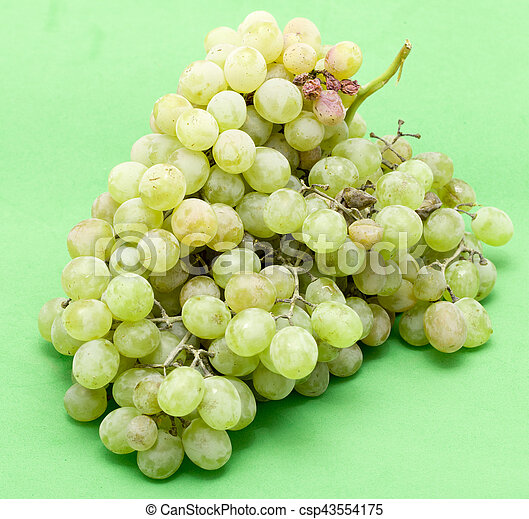 grapes on a green background - csp43554175