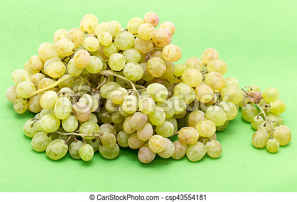 grapes on a green background - csp43554181