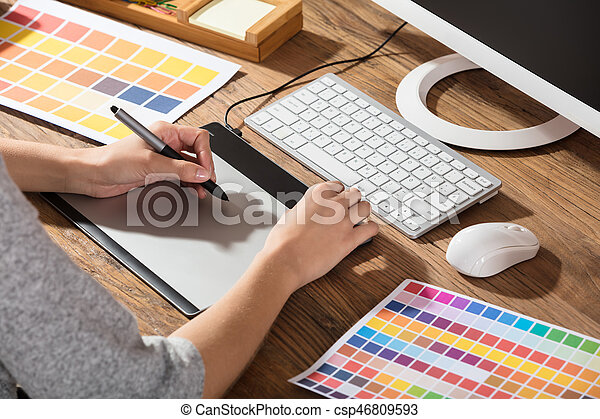 Graphic Designer Using Graphic Tablet - csp46809593