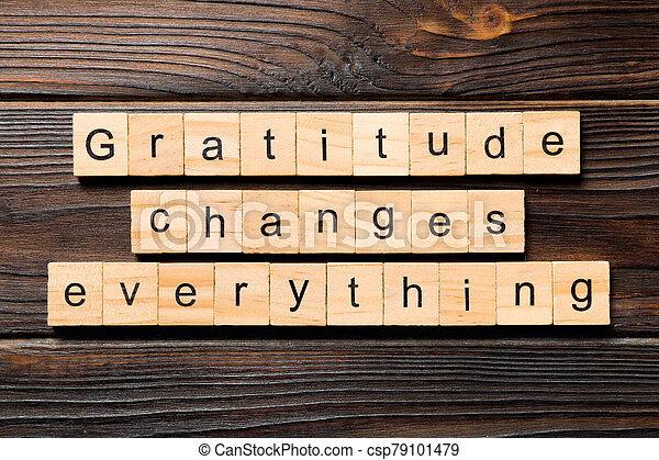 Gratitude changes everything word written on wood block. Gratitude changes everything text on wooden table for your desing, concept - csp79101479