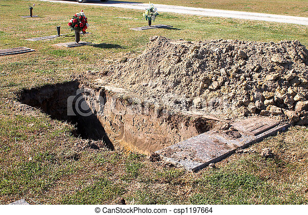 an open grave at a graveyard. stock photo search