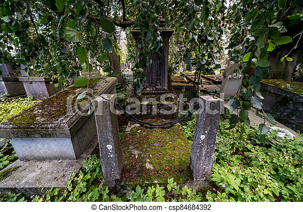 Grave with moss - csp84684392