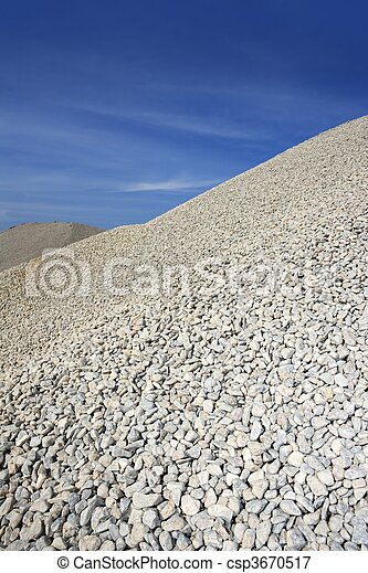 gravel gray mound quarry stock blue sky - csp3670517