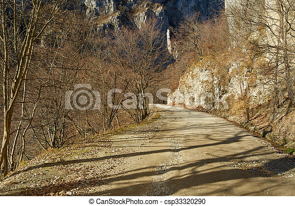Gravel road in the mountains - csp33320290