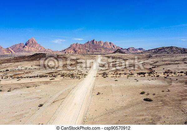 Gravel road to the mountains of spitzkoppe - csp90570912
