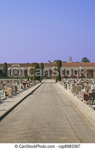 graves  headstones and crucifixes of a cemetery outdoor - csp8983367