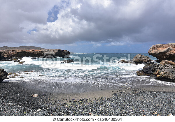 Gray Skies Over the Black Sand Stone Beach on Aruba's East Coast - csp46438364
