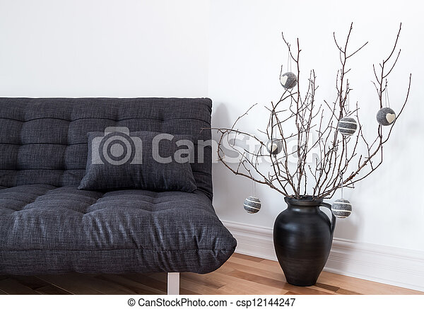 Gray sofa and simple winter decorations - csp12144247