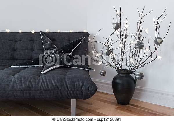 Gray sofa, winter decorations and cozy lights - csp12126391