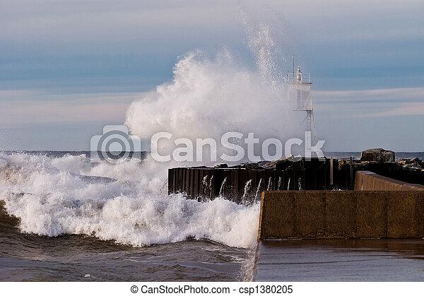 Great Lakes Waves Crashing into Harbor Light - csp1380205