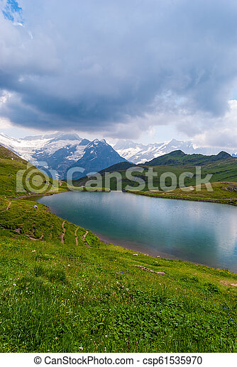 Great view of the rocky mountains. Popular tourist attraction. Location place Bachalpsee in Swiss Alps, Grindelwald valley, Bernese Oberland, Europe - csp61535970