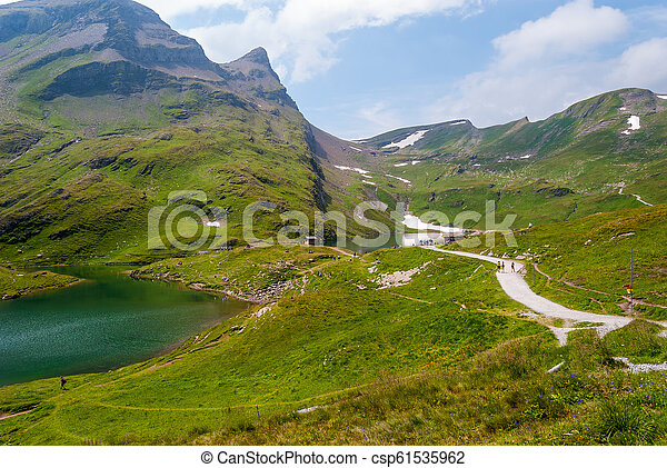 Great view of the rocky mountains. Popular tourist attraction. Location place Bachalpsee in Swiss Alps, Grindelwald valley, Bernese Oberland, Europe - csp61535962