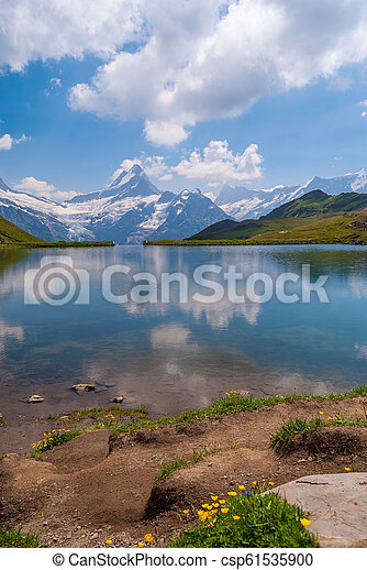 Great view of the rocky mountains. Popular tourist attraction. Location place Bachalpsee in Swiss Alps, Grindelwald valley, Bernese Oberland, Europe - csp61535900