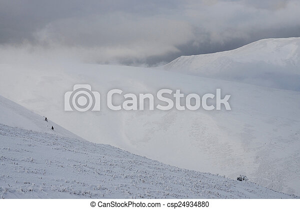 Great winter storm landscape on the slope of Gemba mountain - csp24934880