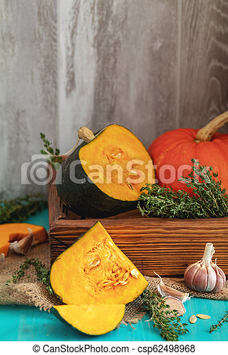 Green and orange Pumpkin and ingredients for tasty vegetarian cooking - csp62498968