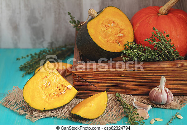 Green and orange Pumpkin and ingredients for tasty vegetarian cooking - csp62324794