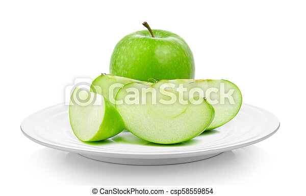 green apple in a plate on white background - csp58559854