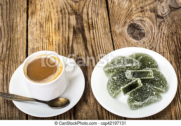 Green apple marmalade and coffee with milk - csp42197131