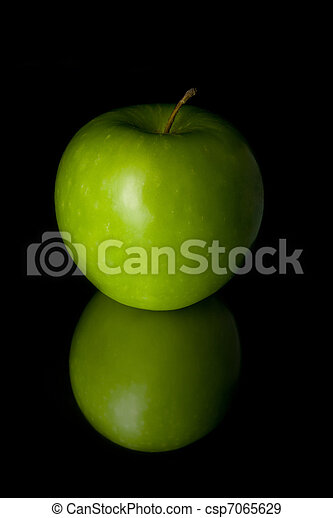 Green apple on the black background - csp7065629