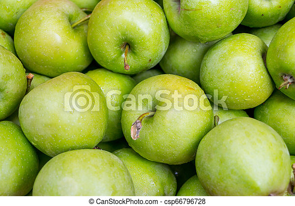green apples in a wooden box - csp66796728